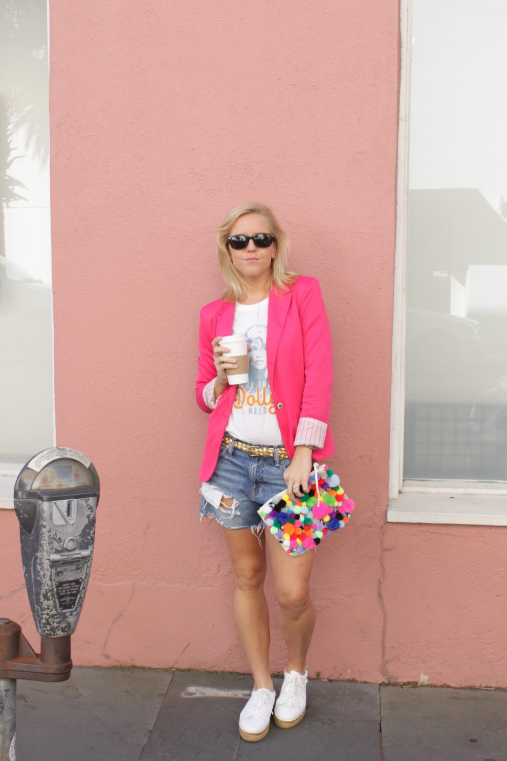 pink blazer and denim shorts