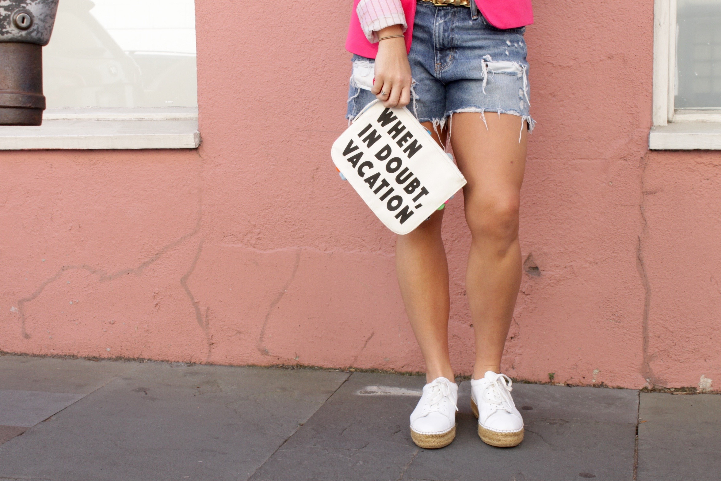 vacation style denim shorts and sneakers